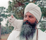 Yogi Bhajan with kitten during Winter Solstice in December 1973